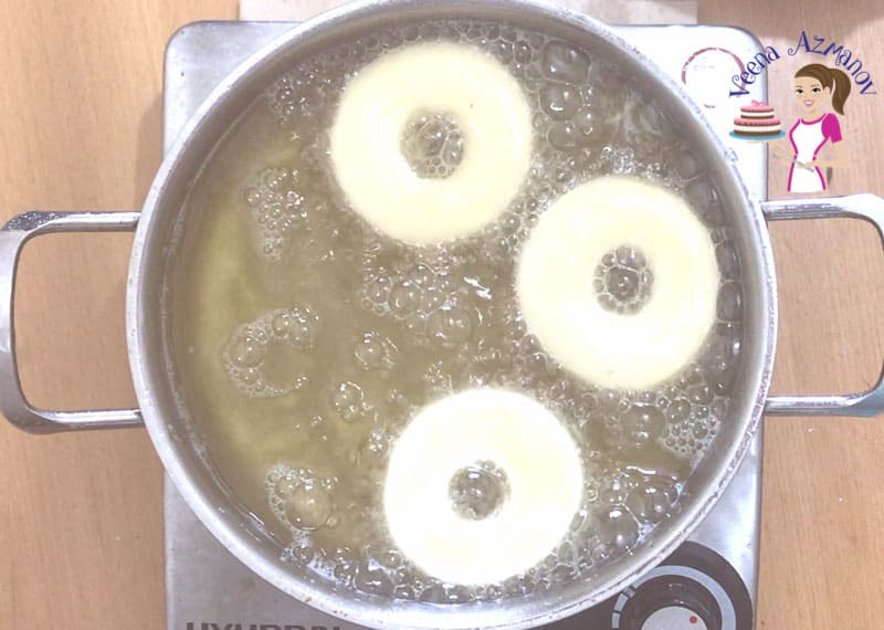 Progress Pictures of Doughnuts - Deep frying the donuts.