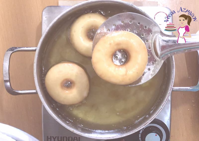 Progress Pictures for perfect donuts recipe - deep frying the donuts in hot oil
