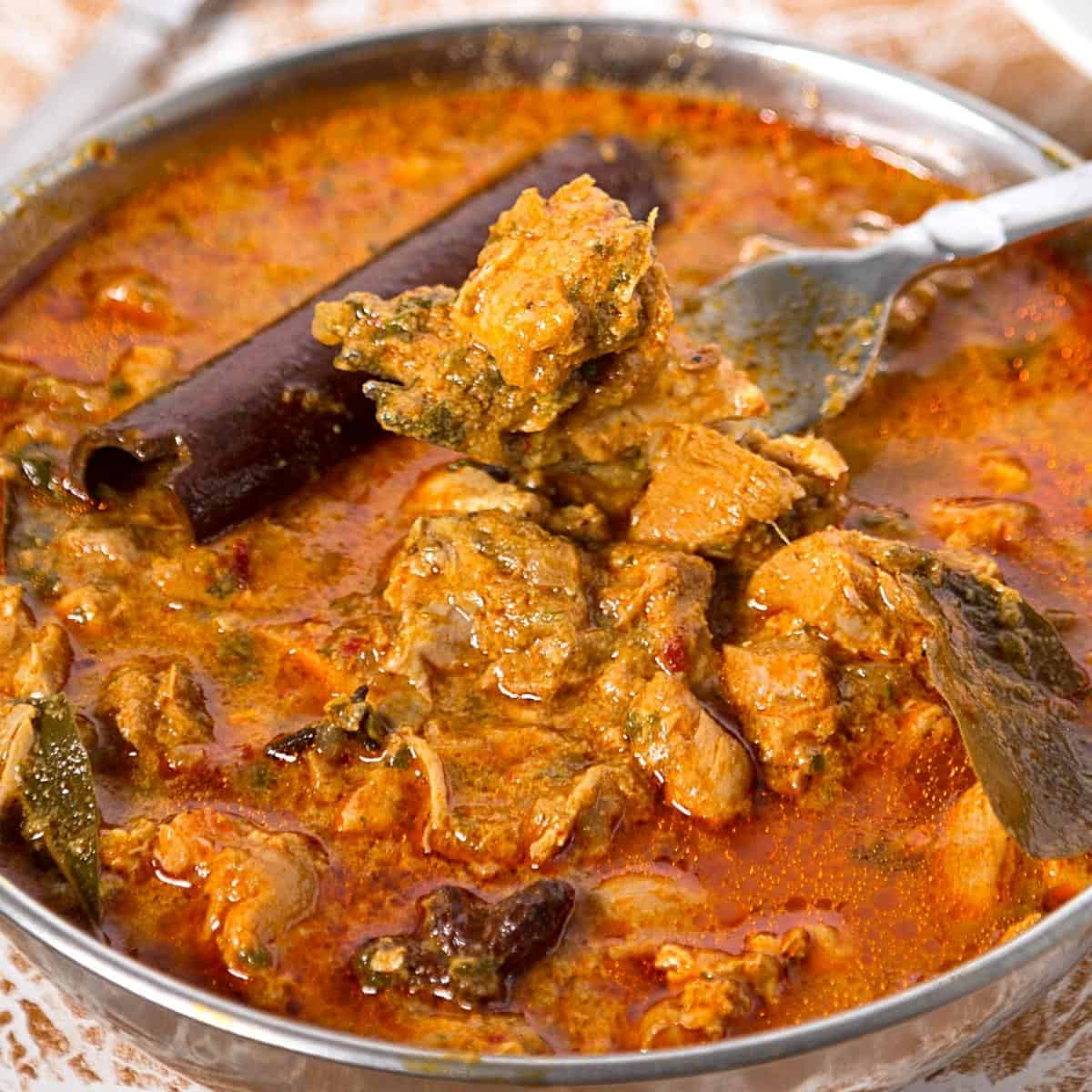 A skillet with chicken curry.