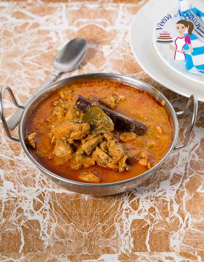 An Indian chicken masala curry served in a Indian bowl.