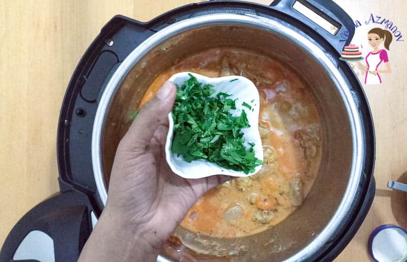 Add the chopped cilantro to the curry chicken in the IP