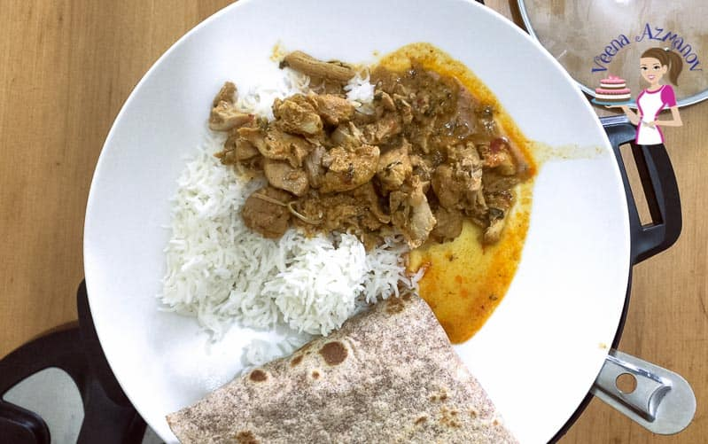 Chicken curry served with white steamed rice and whole wheat chapati.