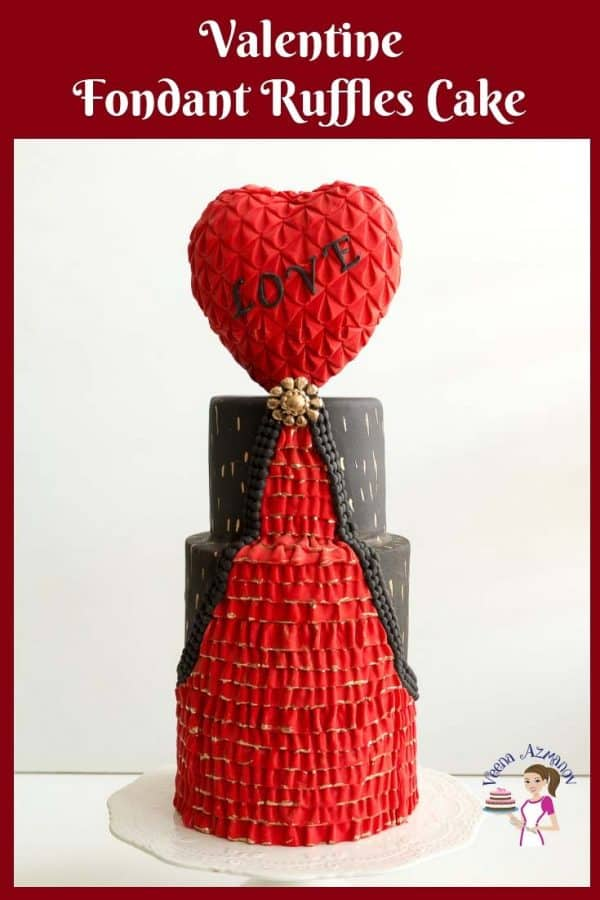 A Valentine's theme decorated cake with a heart-shaped topper.