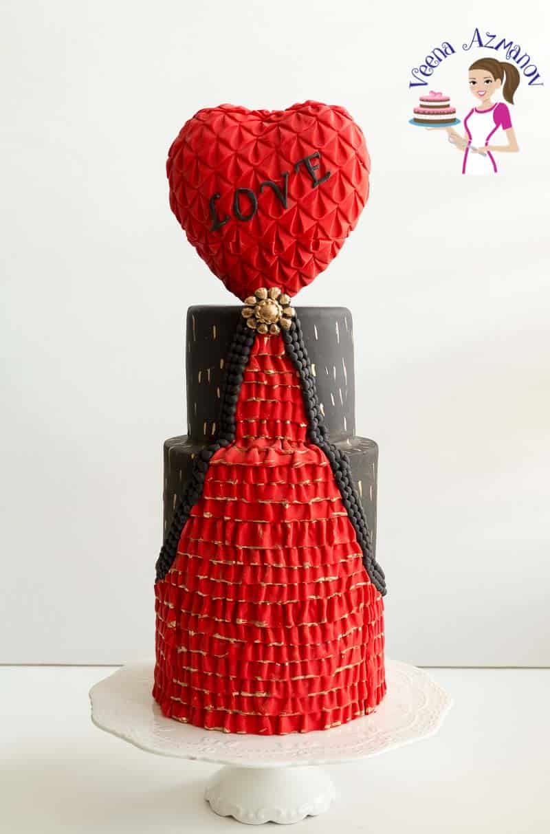 A Valentine's theme cake with a heart-shaped topper.