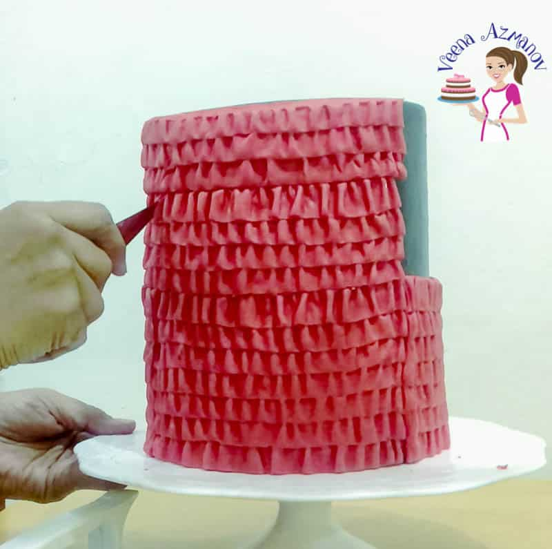 A Red and Black fondant cake with Ruffles - easy cake tutorials by Veena