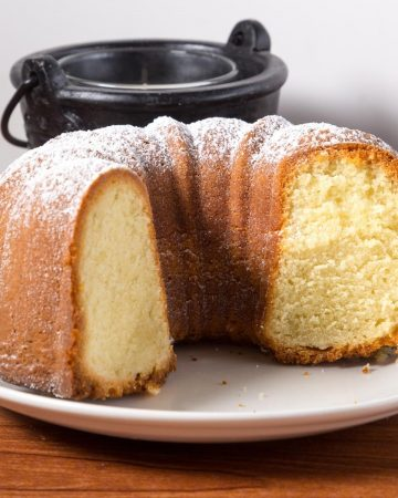 A cut side of the vanilla bundt on a plate