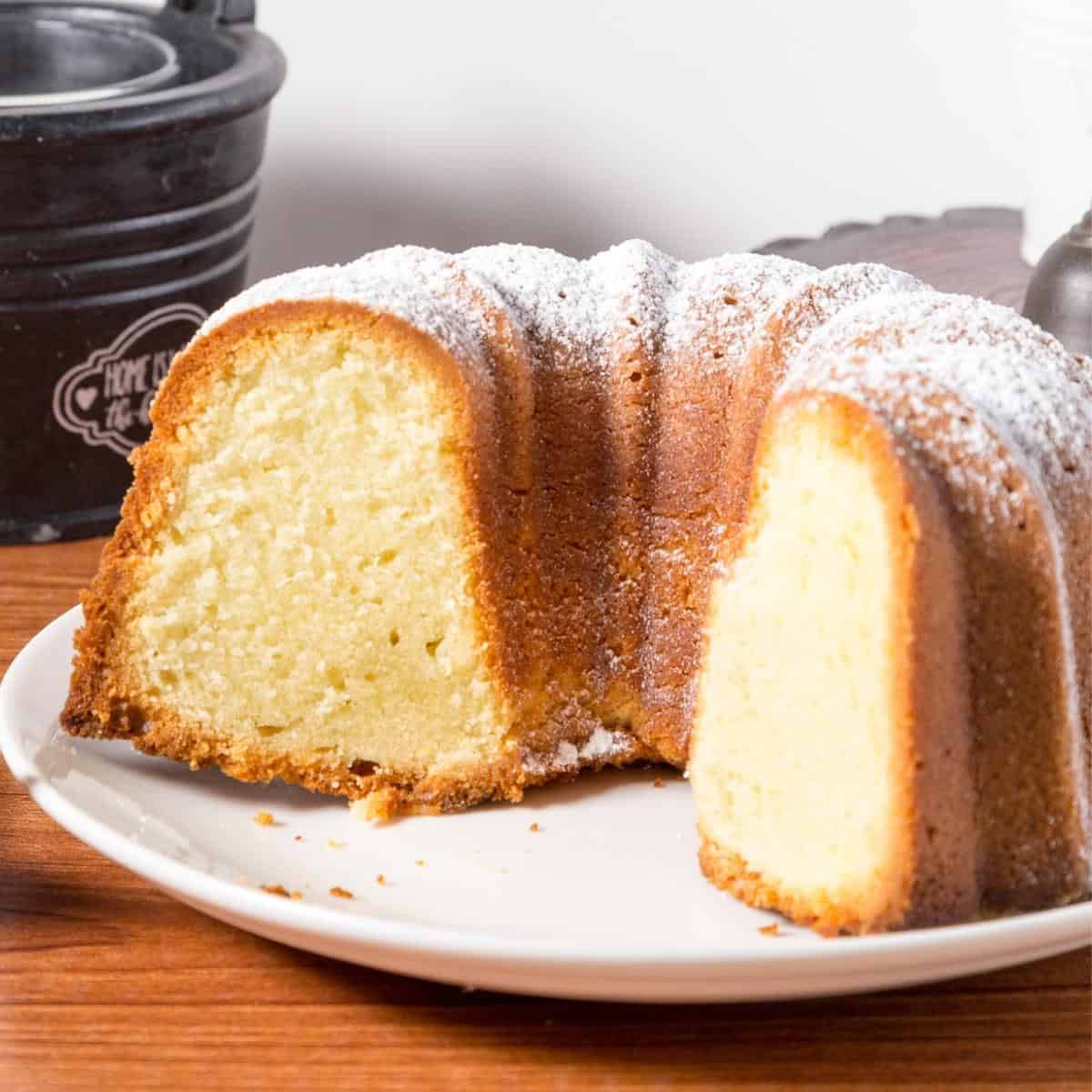 Vanilla bundt on a plate showing the sliced cake