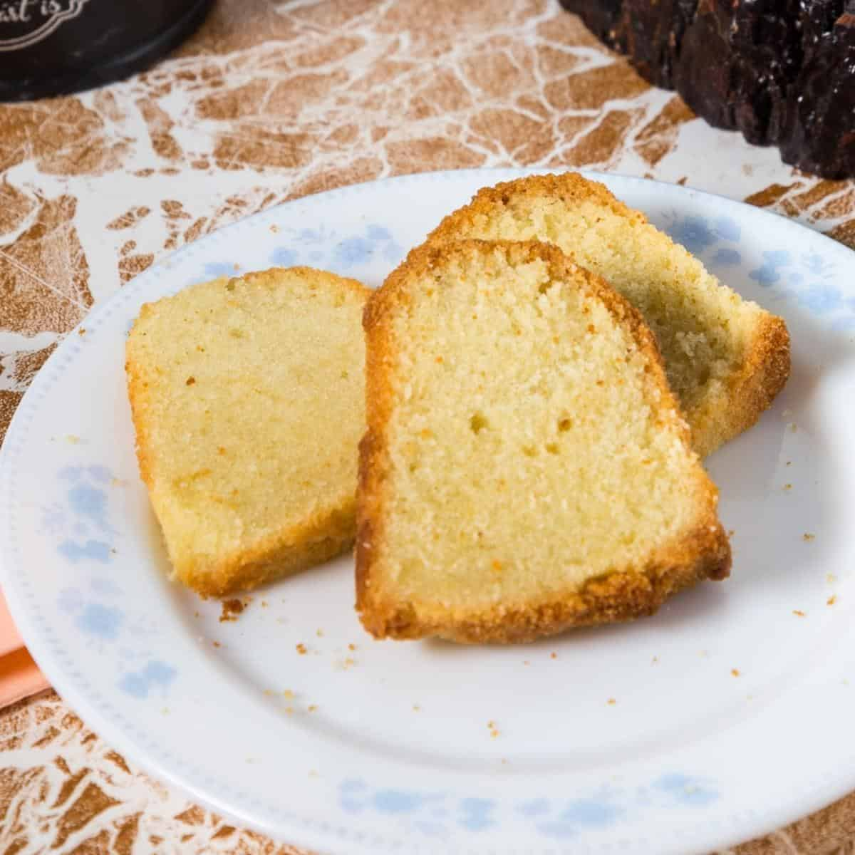 Three slices of cut pound cake on a plate