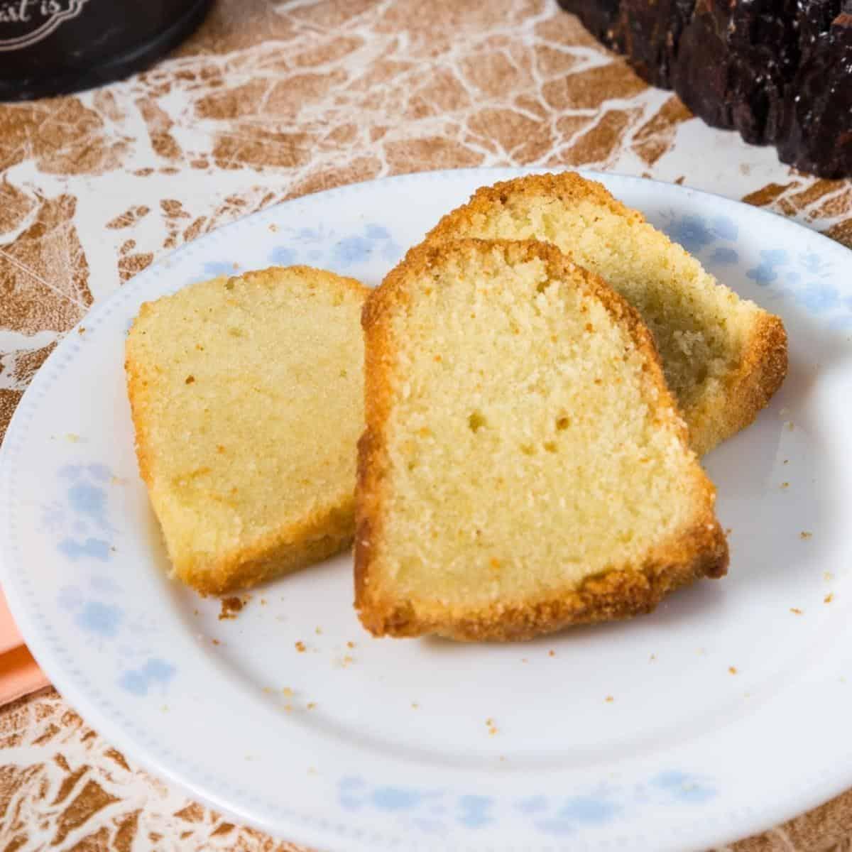 Slices of vanilla bundt cake on a plate.