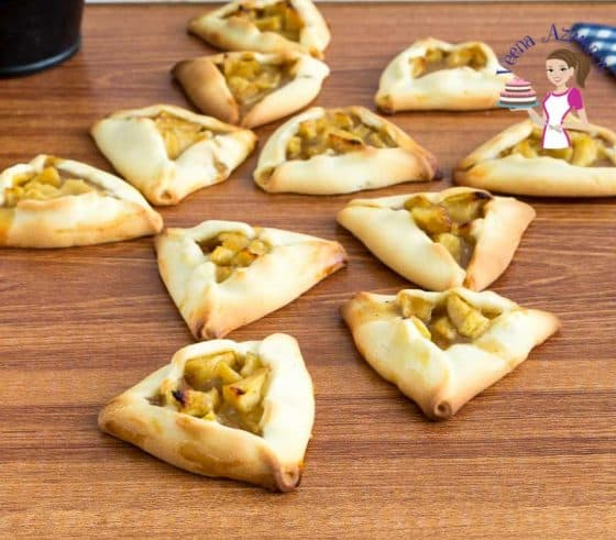 Apple filled hamantaschen cookies on a table.