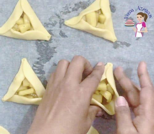 Progress Pictures - Purim Cookies - folding the cookies