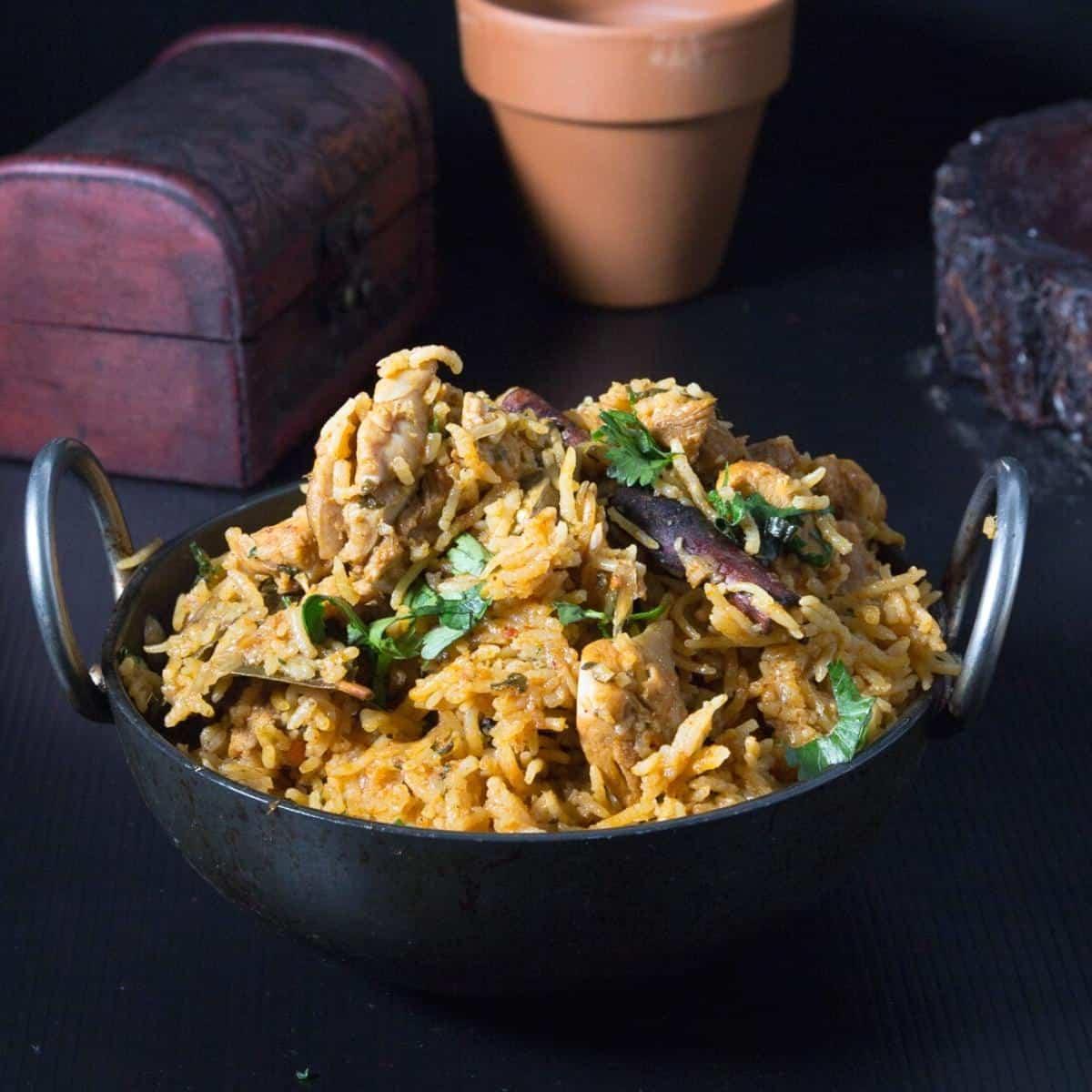 An Indian kadai served with Instant Pot Chicken Biryani.