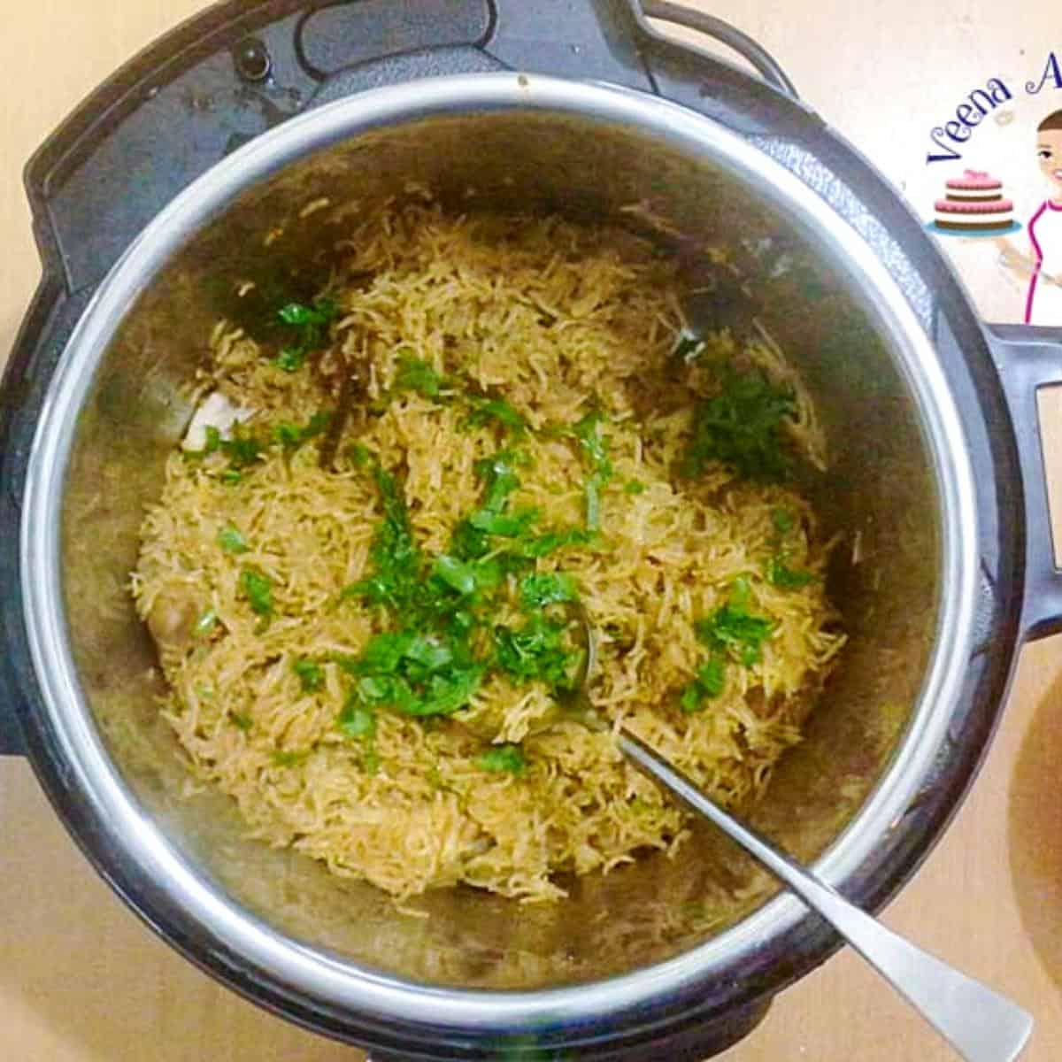 Instant pot with biryani with chicken.