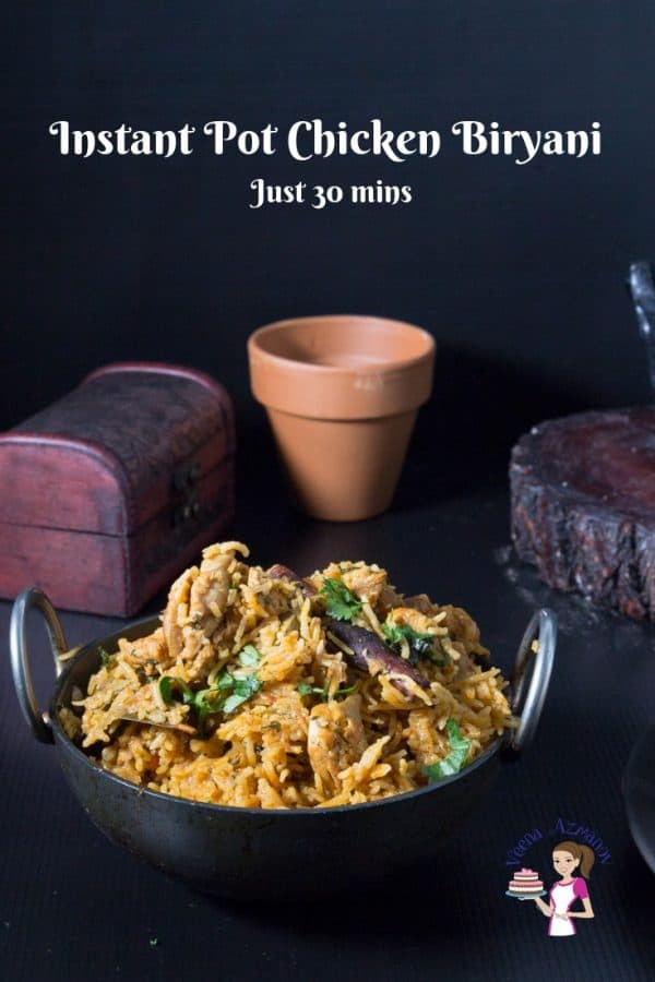 A bowl of chicken biryani on a table.