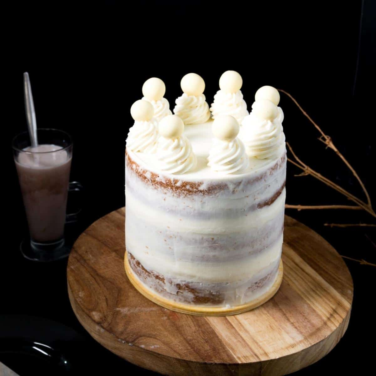 A naked cake on a wooden board
