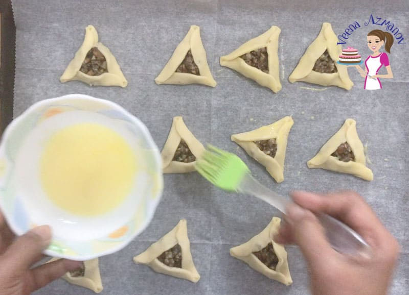 Progress Pictures for the perfect Hamantaschen Cookie with video tutorial - Egg wash the cookies