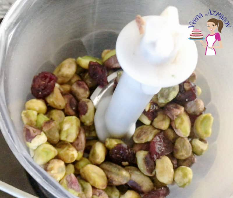 Pistachios in a bowl of a blender.