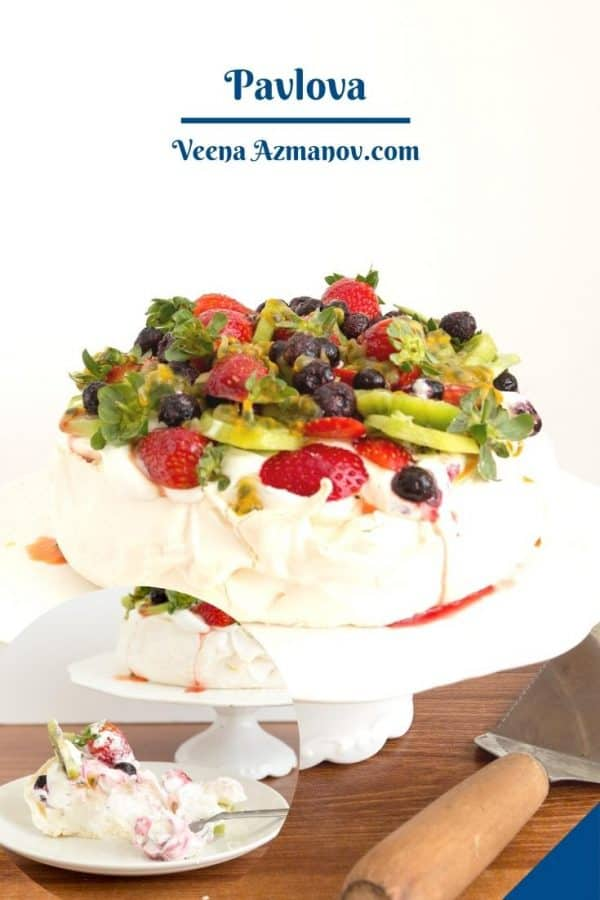 Frosted Pavlova on cake stand.