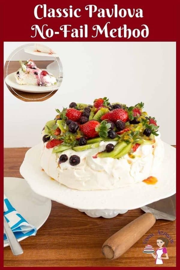A pavlova decorated with berries on a cake stand.