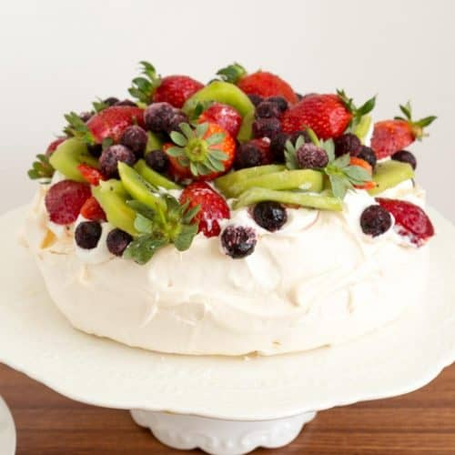 pavlova with whipped cream on the table.