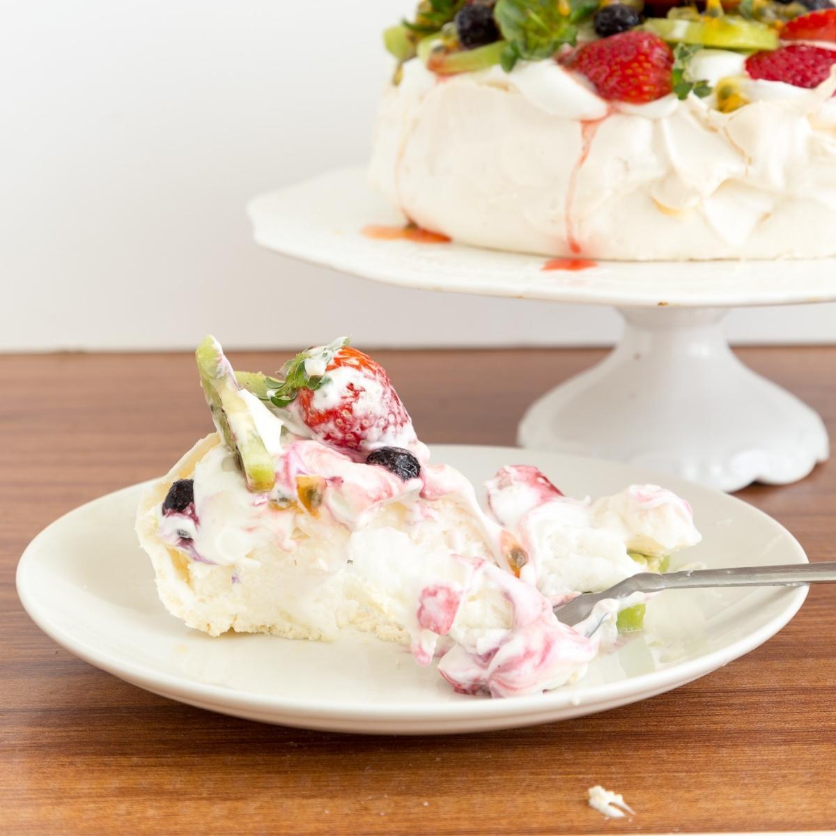 Slice of pavlova with whipped cream.
