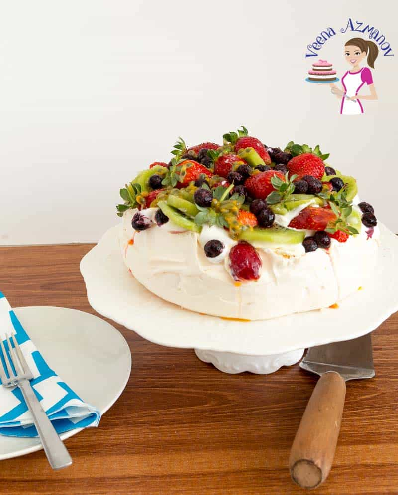 The best Classic Pavlova Recipe with whipped cream and fresh fruits