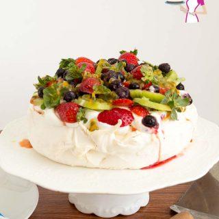 A pavlova on a cake stand.