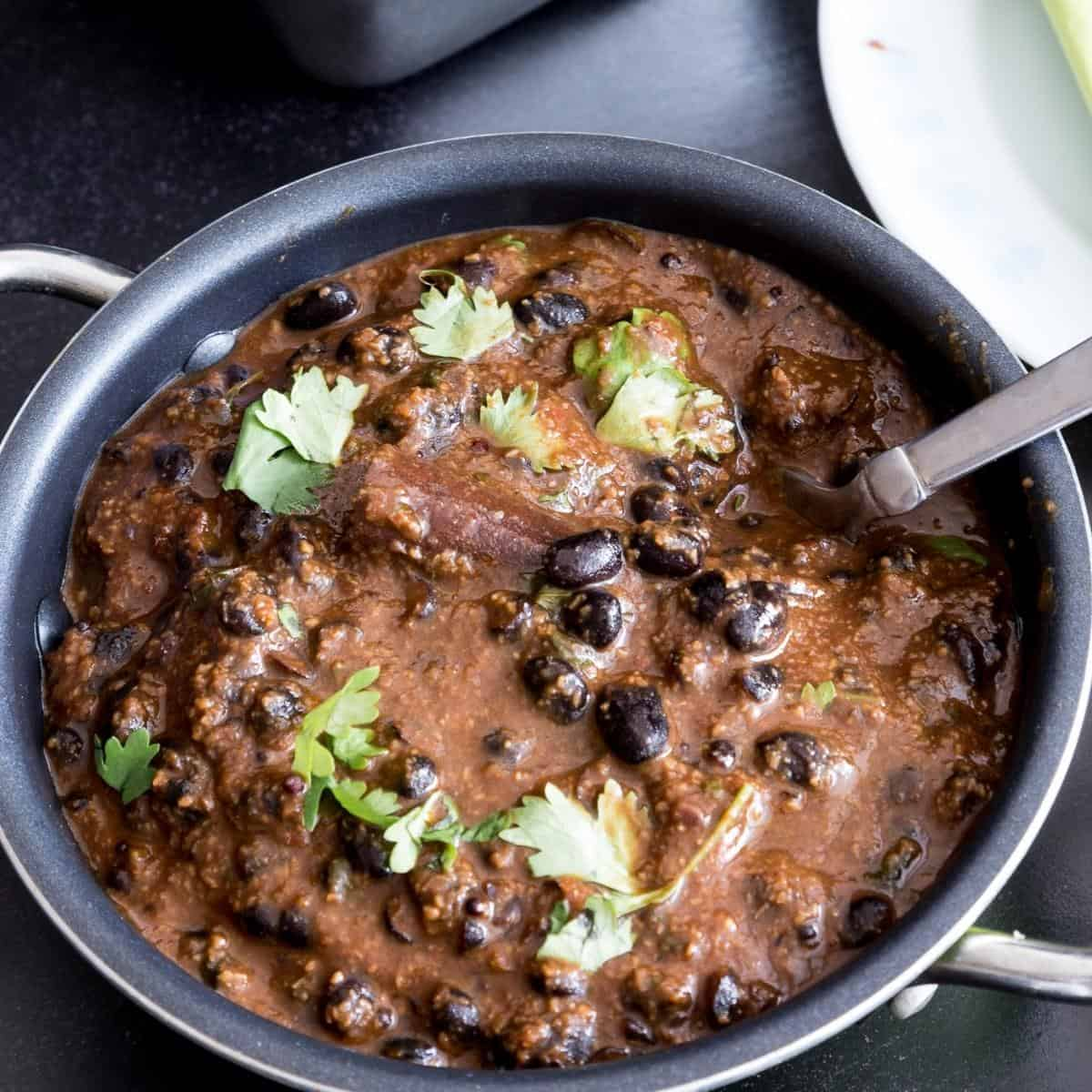 A bowl of black beans curry.