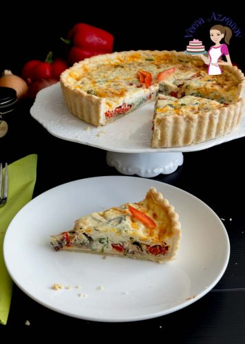 A slice of red peppers quiche on a plate.