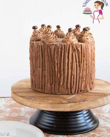 A cake glazed with ganache.