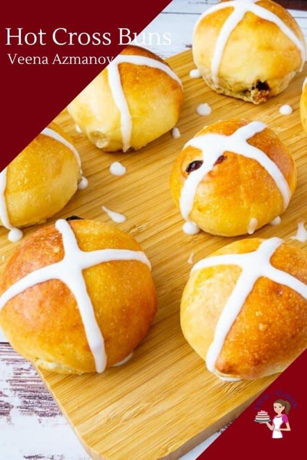 Hot cross buns a wooden board.