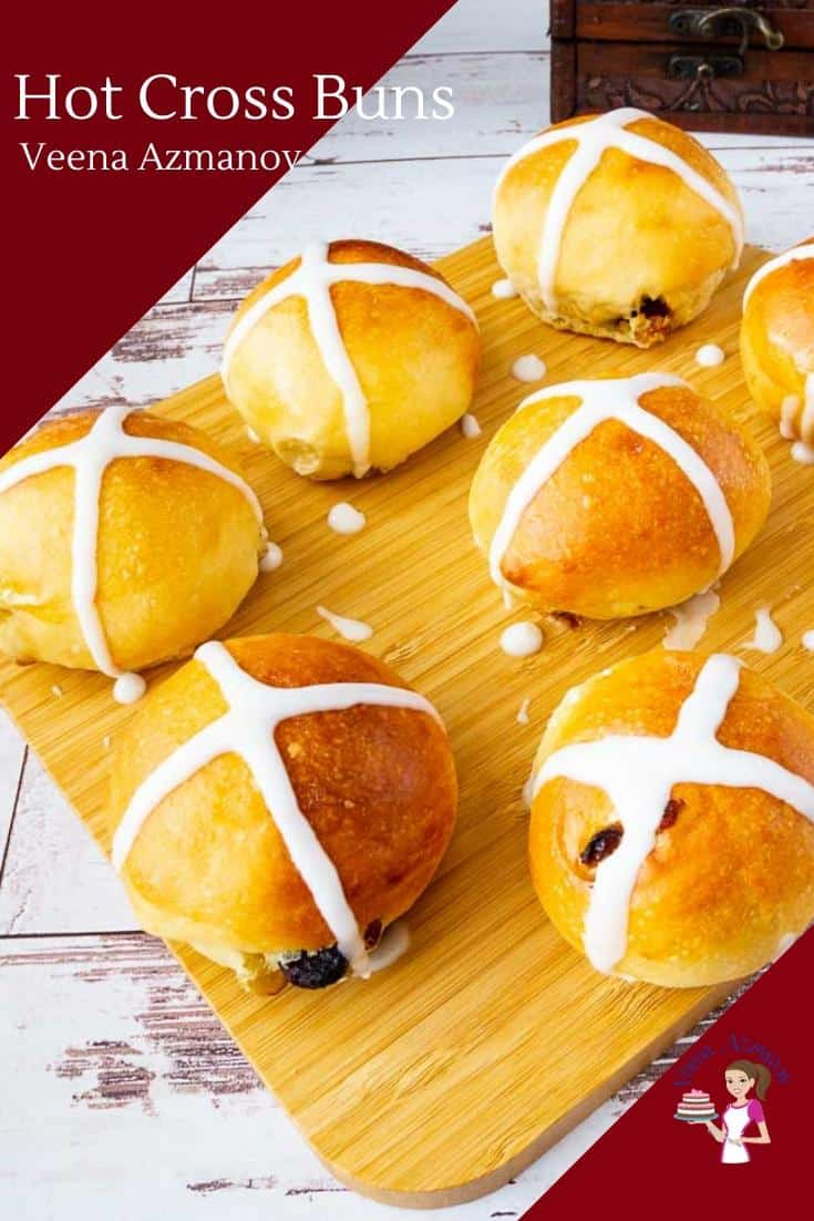 These homemade hot cross buns are soft, buttery and rich. They are studded with raisins and cranberries baked until golden and then iced with a cross on top. Traditionally made for good Friday these are perfect to celebrate during the Easter holidays. #hotcrossbuns #buns #Easterbuns #easterbread #breadforeaster #Hotcrossbun #bunswithcross via @Veenaazmanov