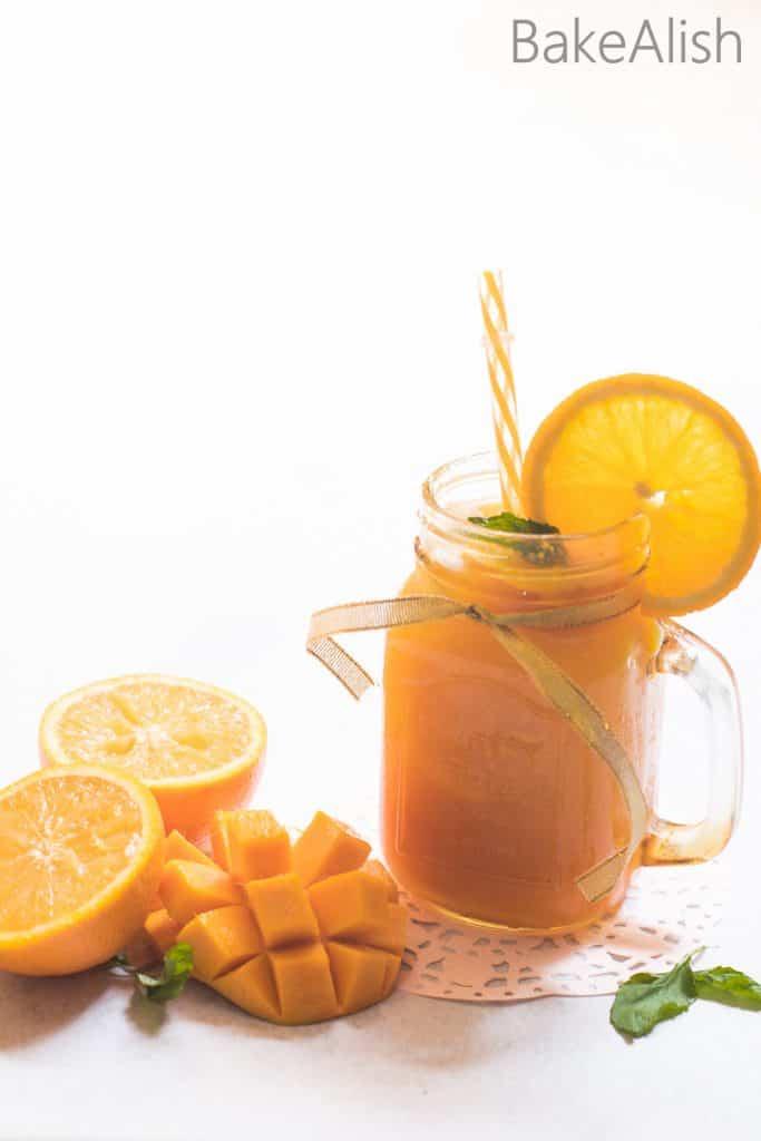 Sparkling Mango Orange- Refreshing Fruit Juice Topped With Mint