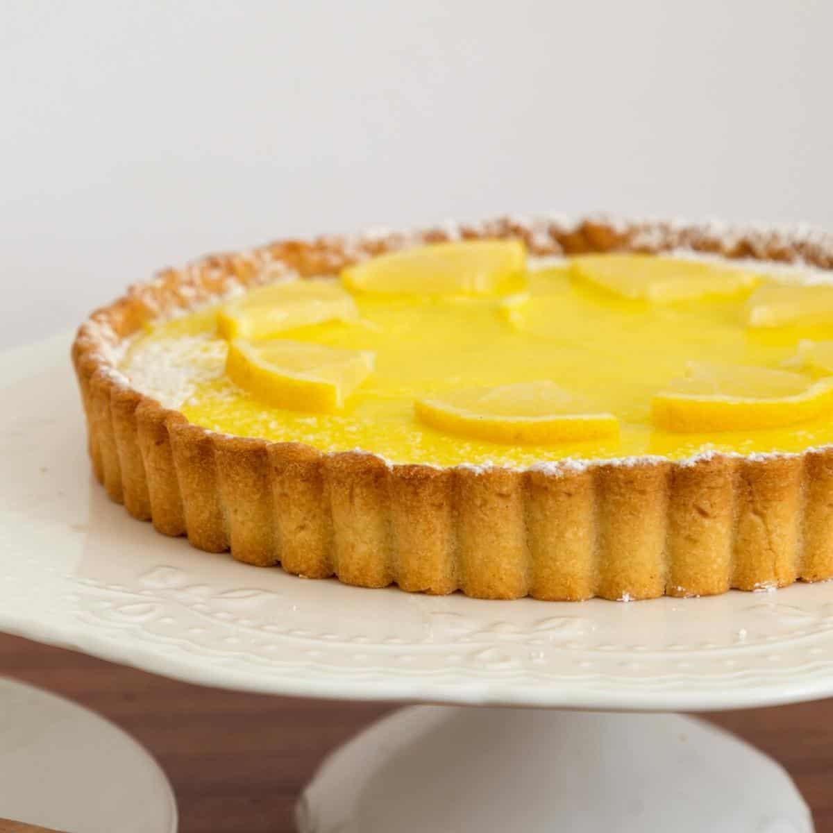A lemon tart using shortcrust pastry.