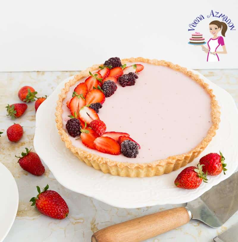 A classic Italian Dessert Panna Cotta with strawberries in a tart.
