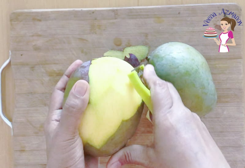 A person peeling mango.