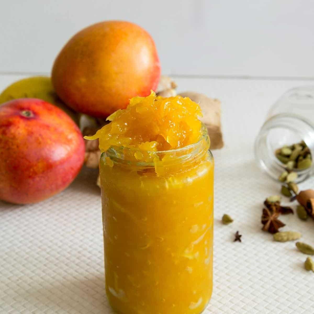 A mason jar with sweet mango chutney.