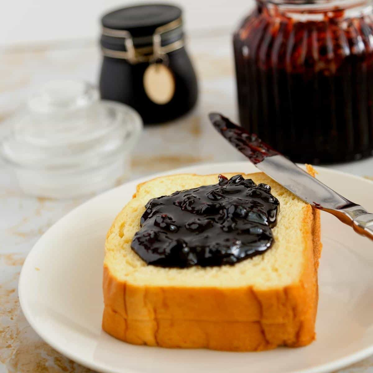 A brioche slice of bread with blueberry jam.