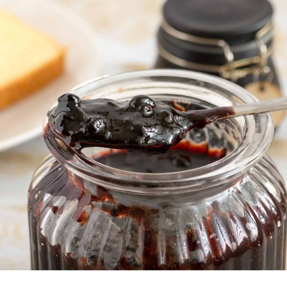 A jar with blueberry jam.