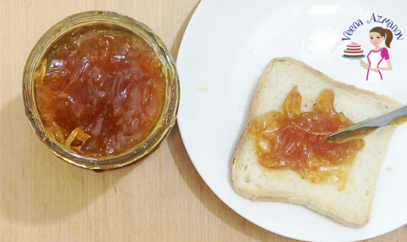A slice of bread with orange jam.