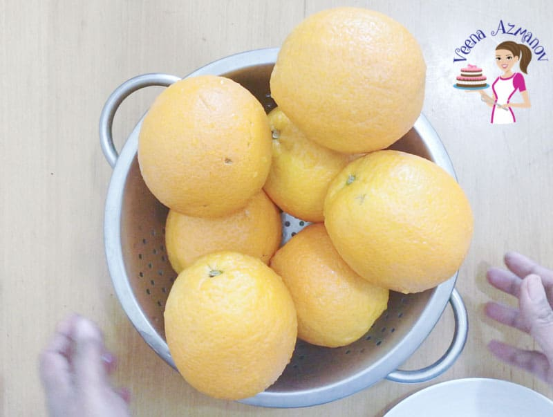 A bowl of oranges on a table.
