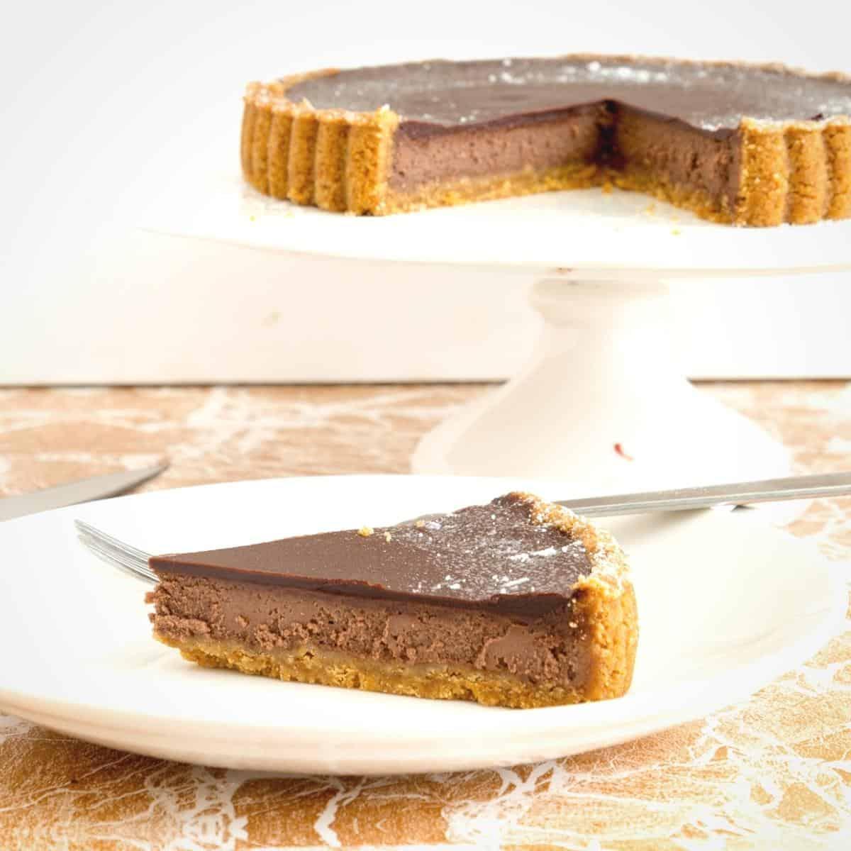 A sliced cheesecake tart with chocolate.