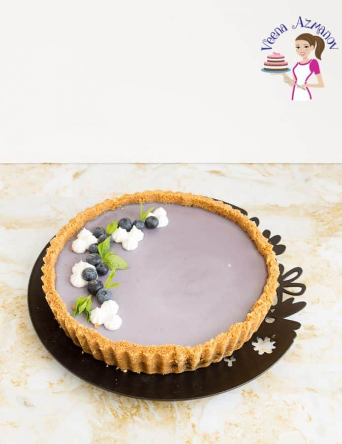 A blueberry panna cotta tart on a plate.