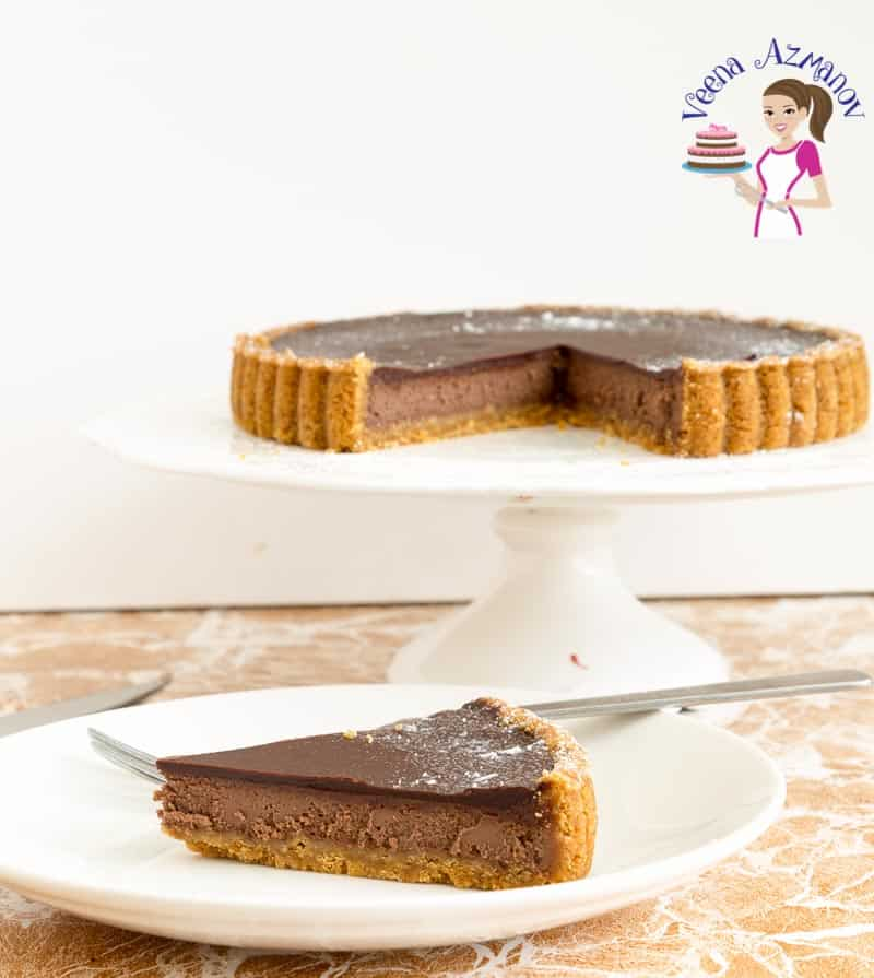 A slice of chocolate cheesecake tart on a plate.