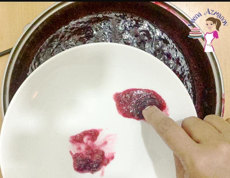 Testing the fruit jam for setting point