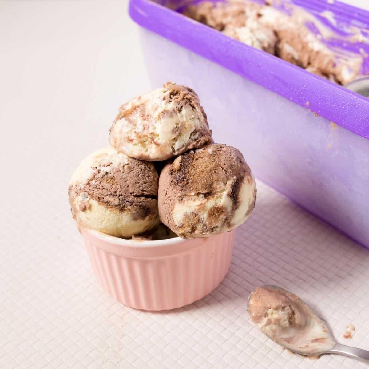 Ramekin with scoops of tiramisu ice cream.