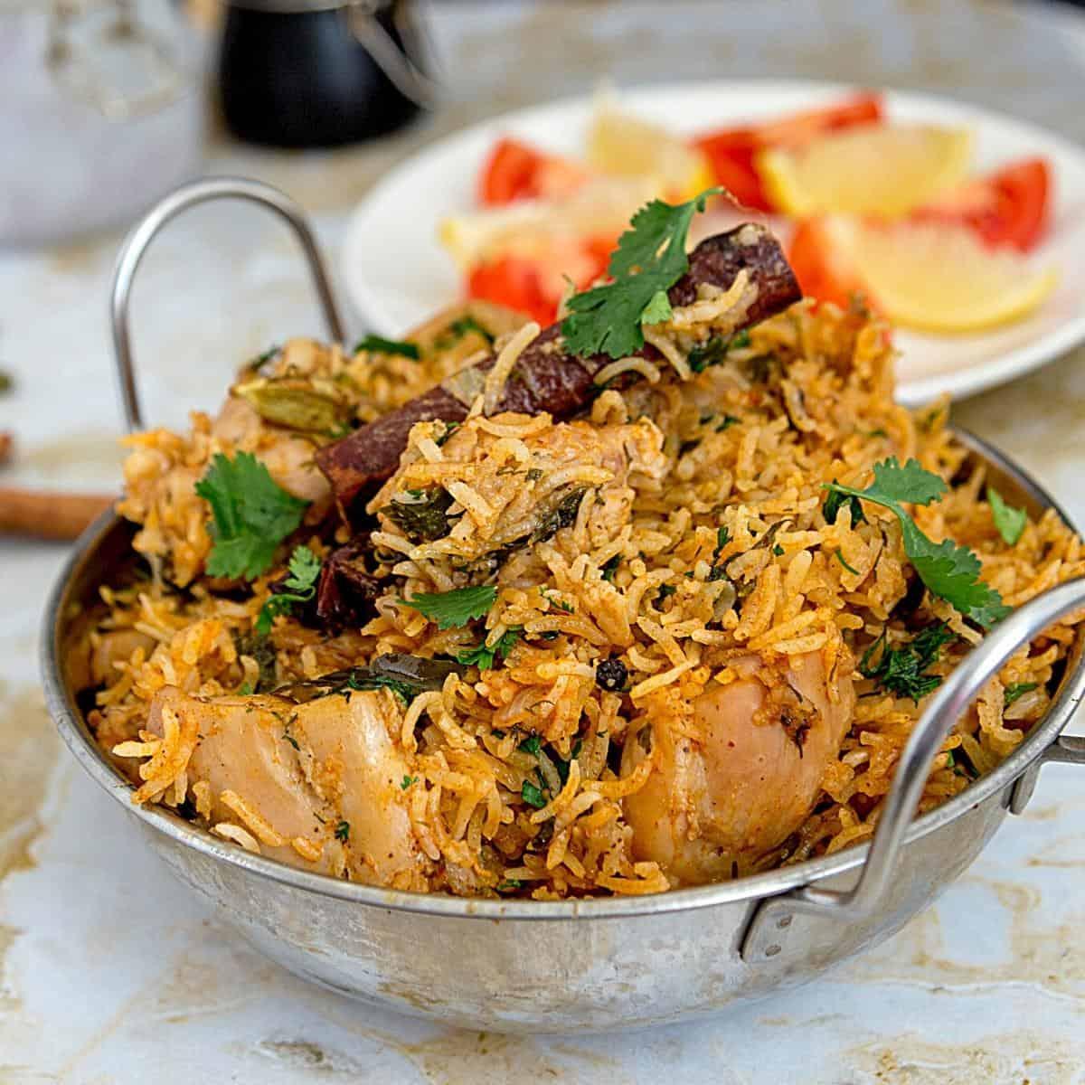 An Indian pot with chicken biryani.