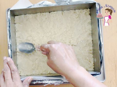 Press the crumble mixture into the base for the cherry bars