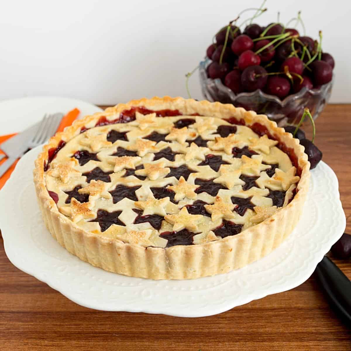 A pie crust baked with cherry filling.