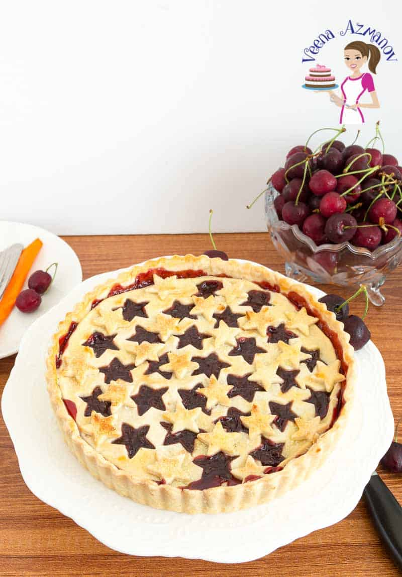 Cherry pie on a cake stand.